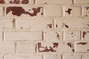 Weathered paint on bricks wall