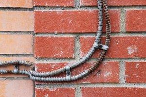 Wiring wires on red bricks