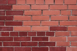 Different masonry red bricks wall
