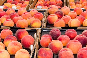 Fresh peaches in boxes