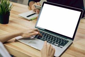 Women using a laptop on white screen