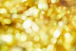 Blur background of gold color bokeh