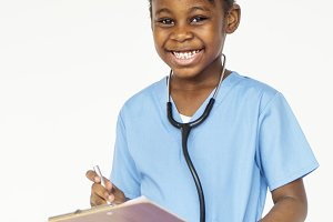 Cheerful kid in doctor uniform