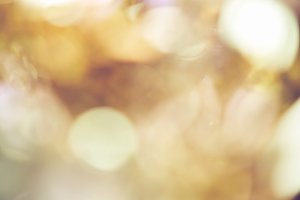 Blur background of gold color bokeh.