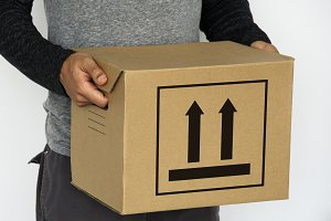 Parcel with this side up sign