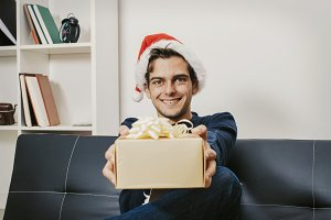 young man with christmas gift