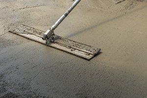 Trowel or float finishing concrete