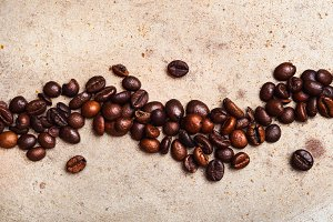 Coffee beans on textured background