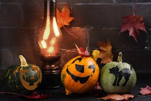 Happy Halloween holiday background with funny pumpkin and autumn leaves