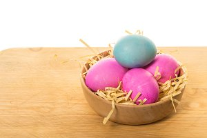 Wooden bowl with Easter eggs
