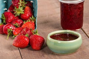 Red strawberries and preserves