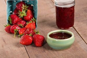 Strawberries with jar of jam