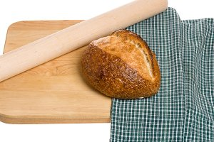 Loaf of bread and rolling pin