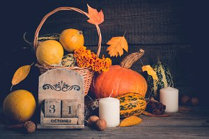 Autumn still life with pumpkins and  falling leaves. Halloween concept, copy space