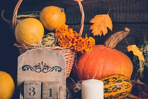 Autumn still life with pumpkins and  falling leaves. Halloween concept.