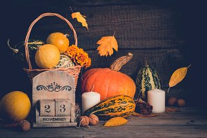 Autumn still life with pumpkins and falling leaves. Thanksgiving concept, copy space