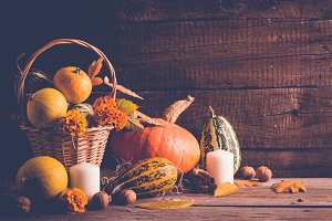 Autumn still life with pumpkins and fallen leaves. Thanksgiving concept, copy space