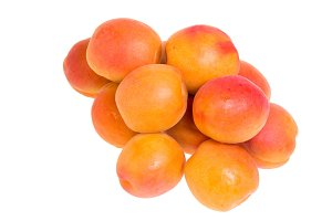 Yellow ripe apricots isolated
