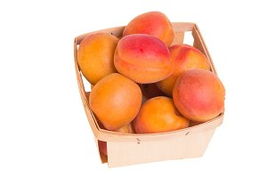 Box of apricots isolated