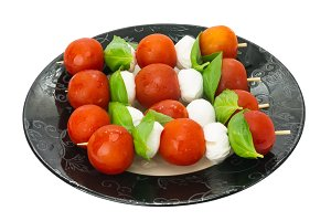 Skewers of tomatoes and cheese