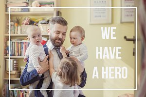 Hipster father holding little daughters. Fathers day concept.