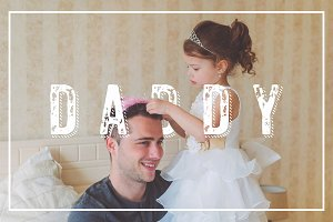 Little girl with father wearing crowns. Fathers day concept.