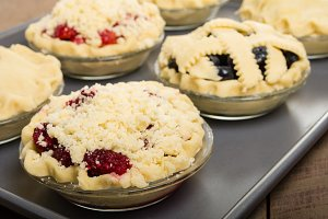Tray of filled fruit pies