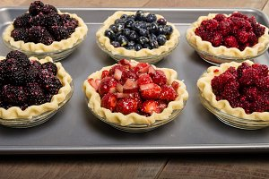 Tray of fruit pies filled