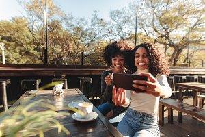 Two women having fun taking a selfie