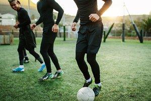 Teenagers practicing football