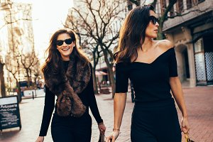 Female friends walking on the city