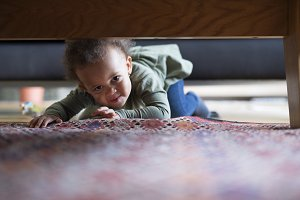 Little girl crawling at home.