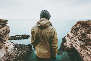 Man traveler looking at cold sea