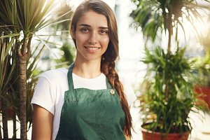 Portrait of young female gardener looking at camera, owner of an online garden supplies store
