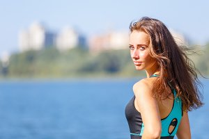 Portrait of young sporty woman resting after jog