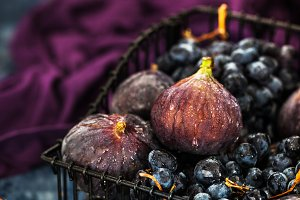 Fresh figs and purple grape