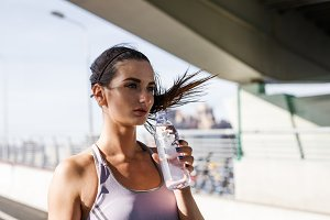 Fit woman holding a bottle