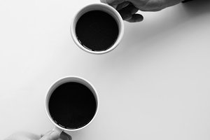Hands holding coffee cups aerial