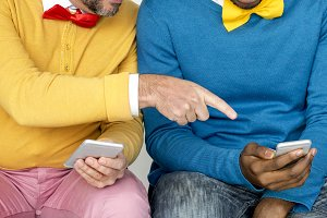 Two colorful men and their phones