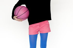 a woman with a pink basketball