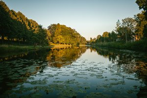 Lake and Park on sunset Sun
