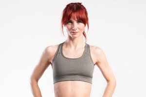 Attractive young fitness woman in sports bra. Studio shot.