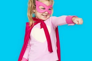 Young girl in superhero costume