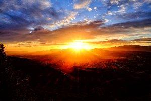 Sun rising over mountains