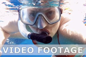 Woman dive underwater in snorkeling diving mask