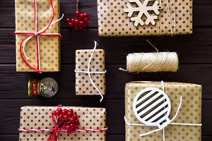brown dotted  boxes with gifts for winter holidays