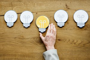 Hand Show Light Bulb