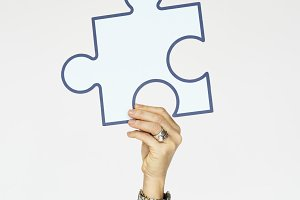 Hand holding jigsaw puzzle