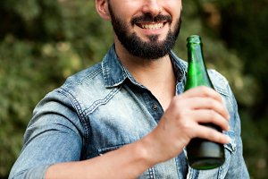 Attractive guy drinking a beer