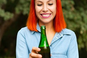 Attractive girl with a beer